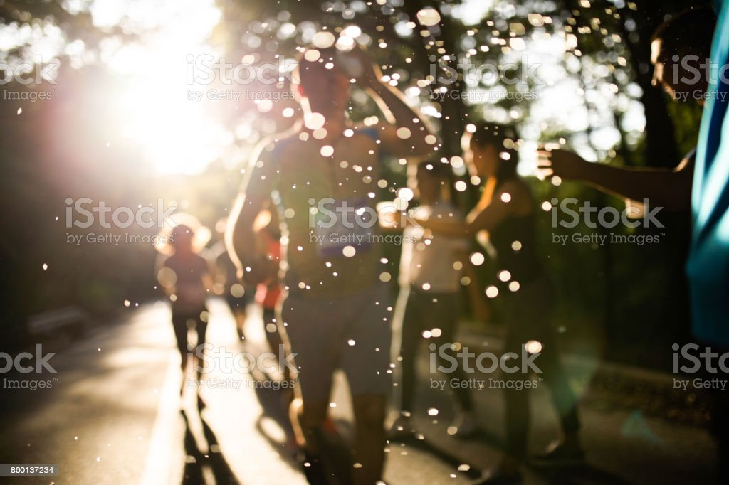 Water drops during marathon race refreshment break! stock photo