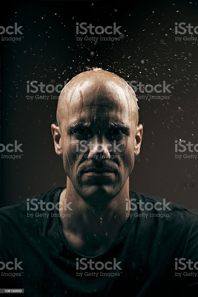 Water Drops Falling and Splashing on Young Man's Head royalty-free stock photo