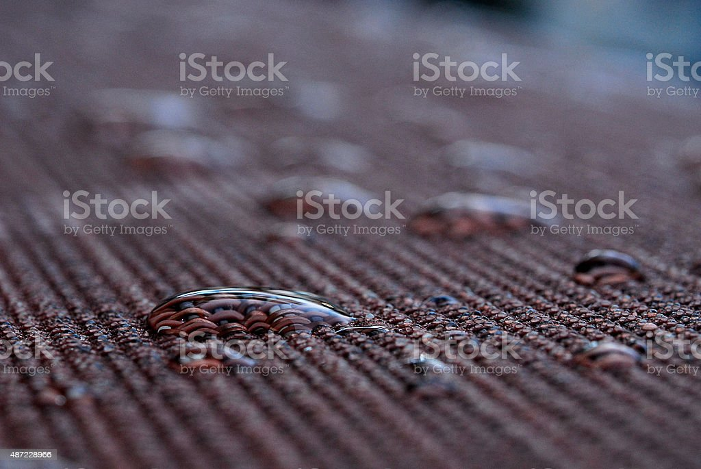 Water Drops on A Patio Chair stock photo
