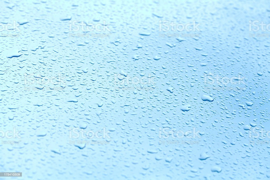 Water drops on a polished blue motorhood royalty-free stock photo
