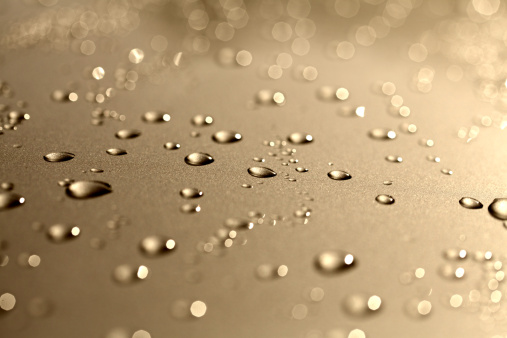 water drops on metallic color background