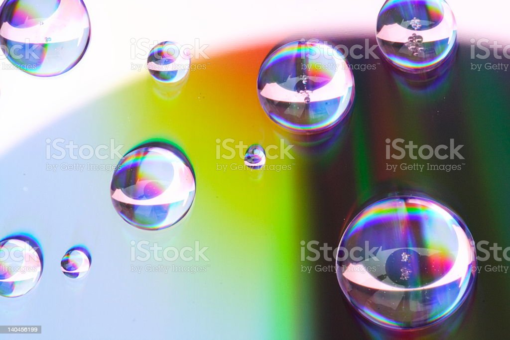 Water drops on a prismatic surface royalty-free stock photo