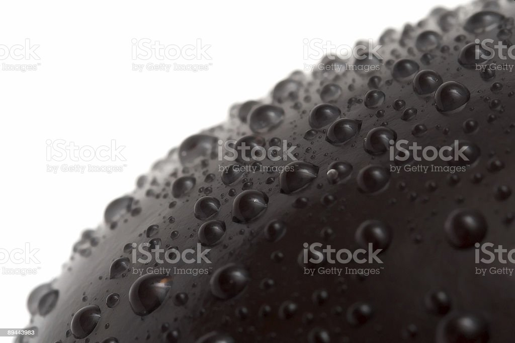 water drops on aubergine's surface royalty-free stock photo