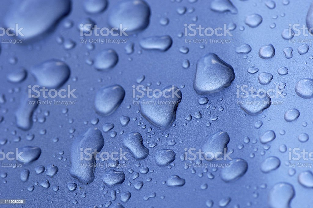 Water Drops on Blue Metal Close Up royalty-free stock photo