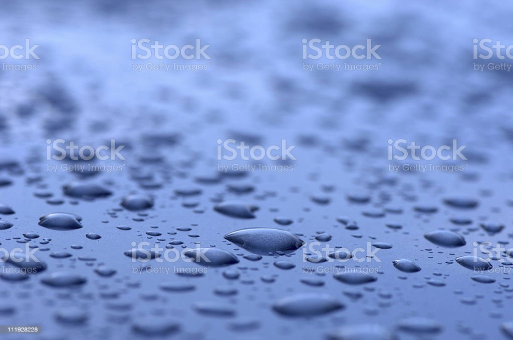 Water Drops on blue metal surface royalty-free stock photo