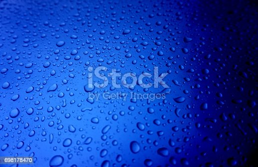 istock Water drops on blue surface 698178470