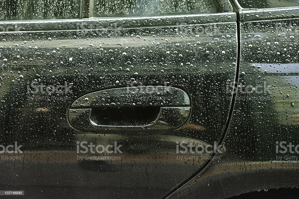 Water drops on car lateral side royalty-free stock photo