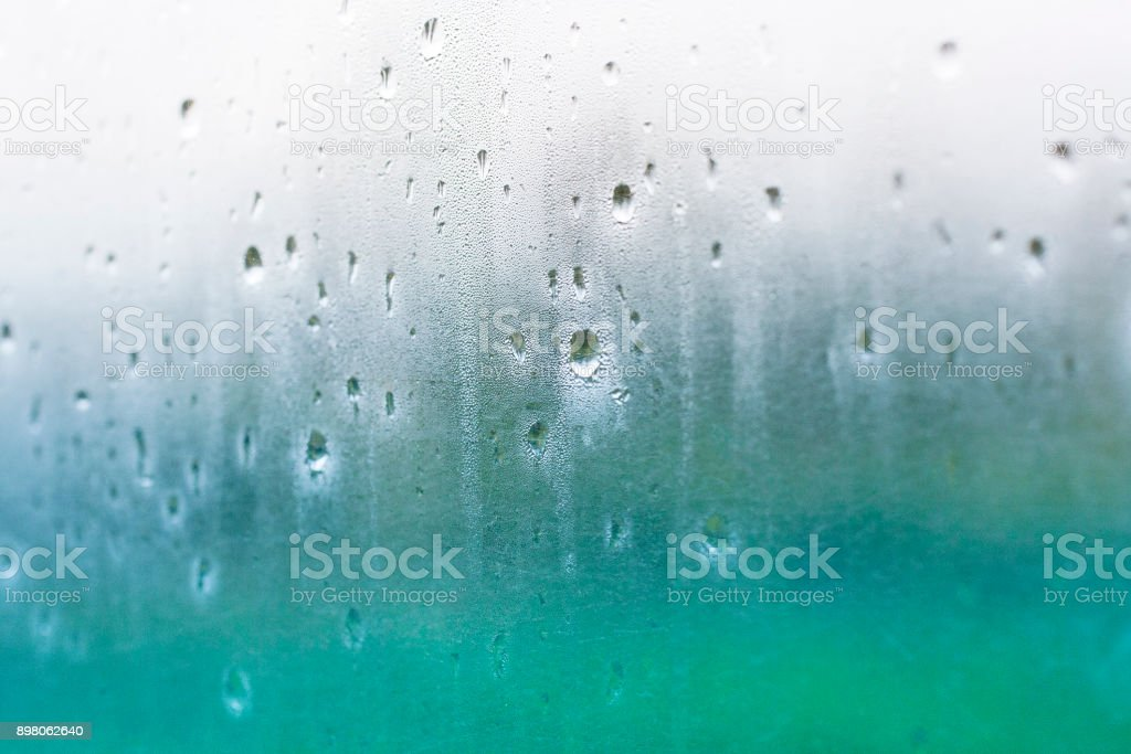 Water drops on misted glass stock photo