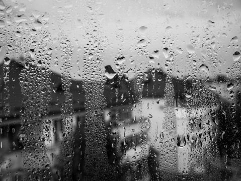 Water drops on the glass window on a rainy day