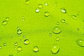 istock Water drops on the green waterproof fabric 1277333052