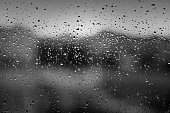 Water drops on window after heavy rain as texture or background