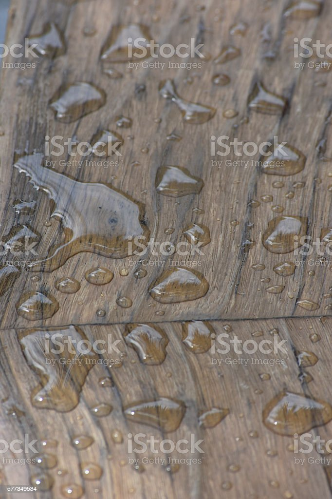 Water drops on wood stock photo