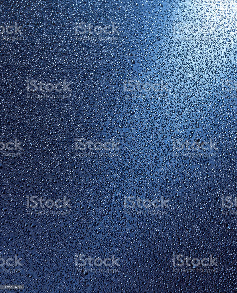 Water drops over stainless steel in blue stock photo