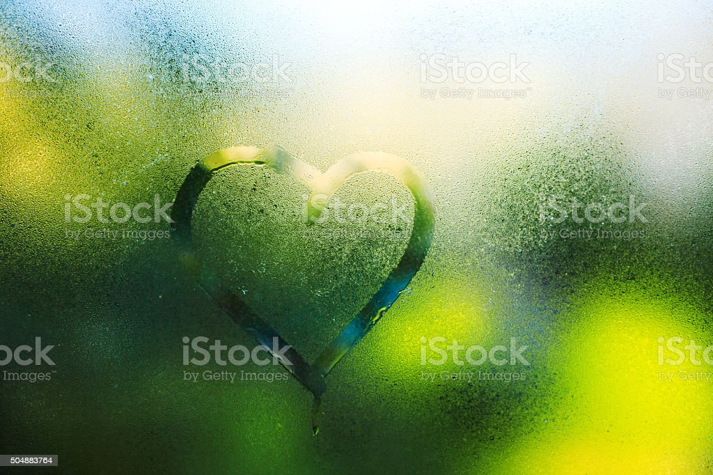 Water drops. Spring rain, the inscription on the sweaty glass stock photo