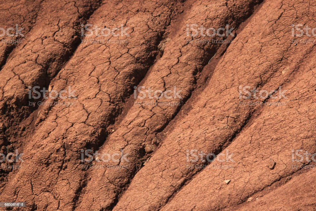 Water erosion on the cracked clay slope stock photo