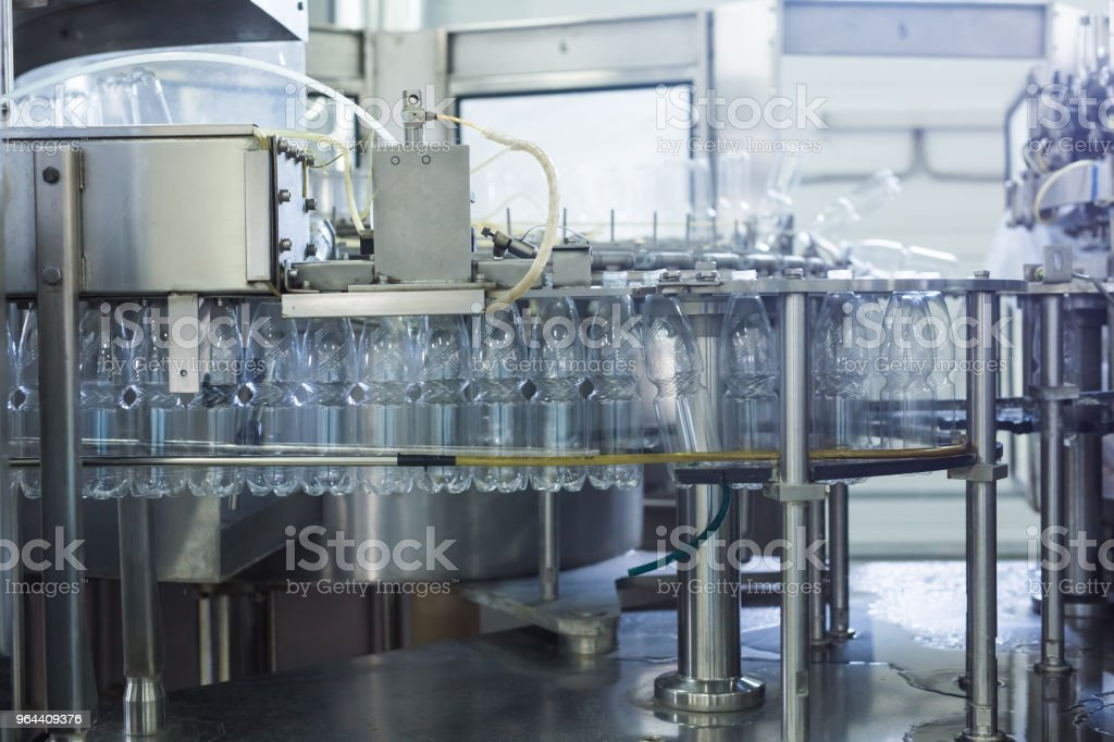 Water factory - Water bottling line for processing and bottling pure spring water into small bottles - Royalty-free Automated Stock Photo