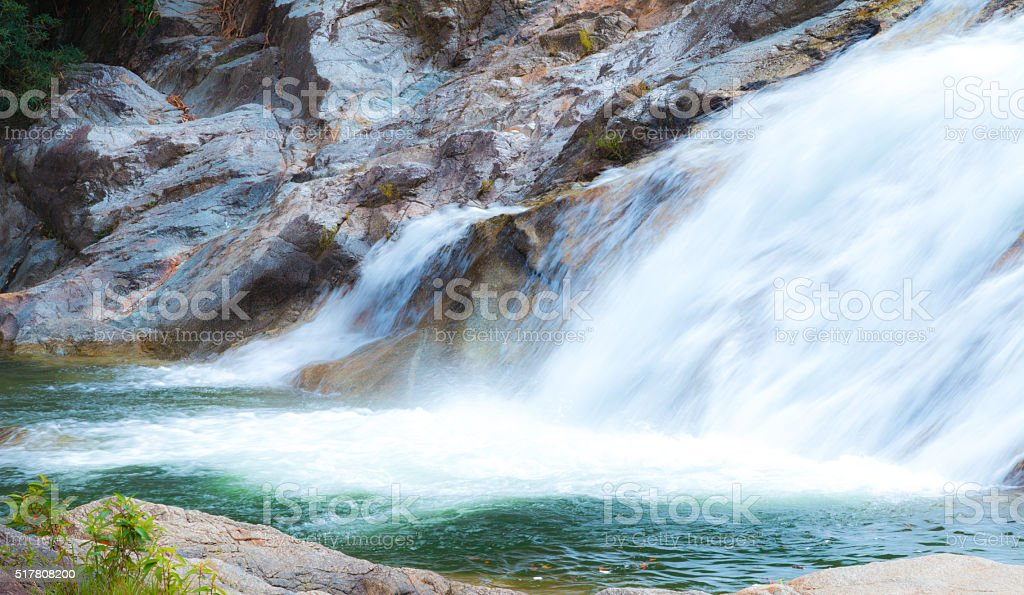 Water fall as a tourist destination for a family holiday. stock photo