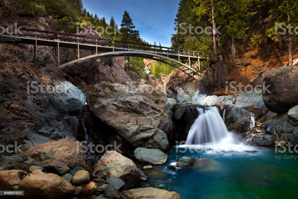 Water Fall with Foot Bridge crossing. Part of the Pacific Crest Trail. stock photo