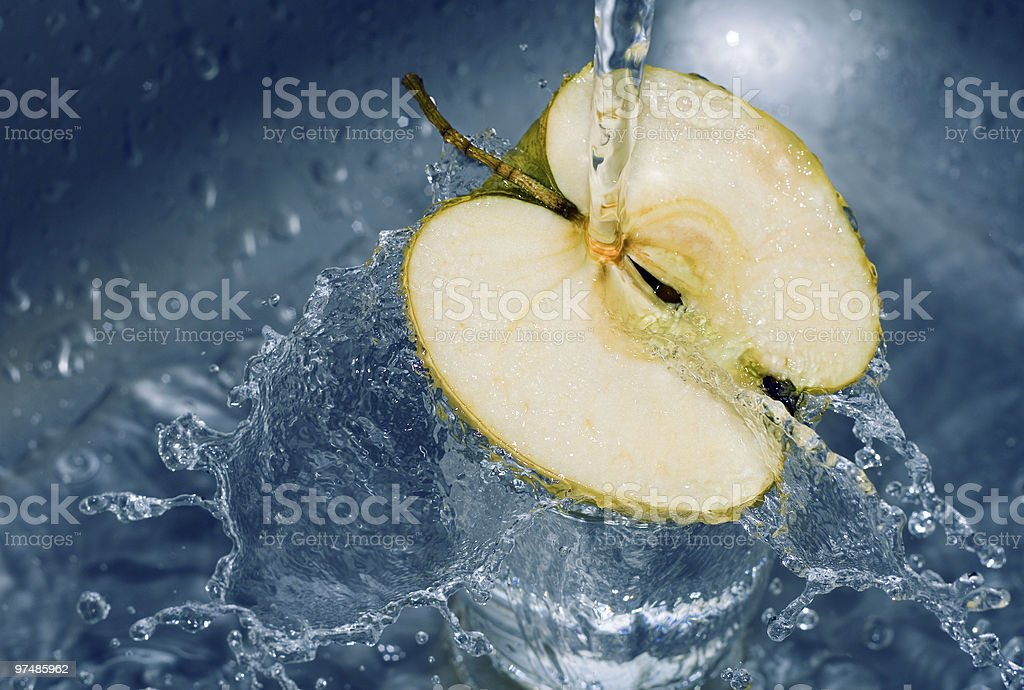 Water falling on sliced apple royalty-free stock photo