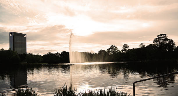 water feature at the park with deep reflections of the cityscape in the background - deign stock pictures, royalty-free photos & images