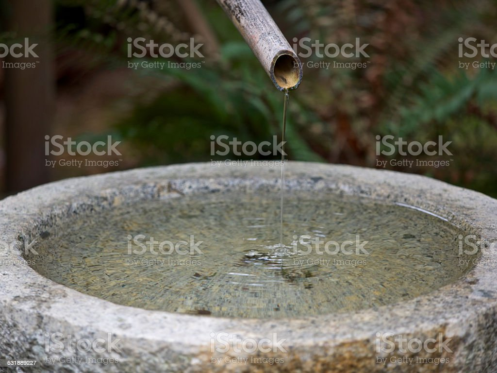 Water Feature Bamboo Rod Stone Bowl Portland Japanese Garden Oregon stock photo