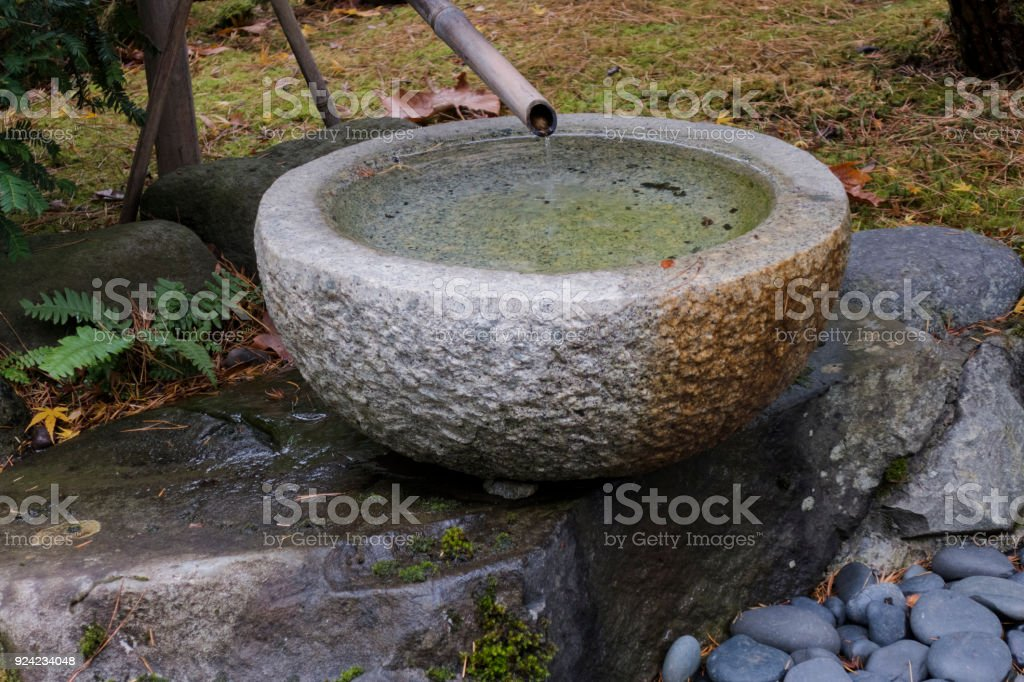 Water Feature Bamboo Stone Bowl Portland Japanese Garden Oregon  Royalty Free Stock Photo
