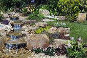 Running water fountain in a formal rose garden