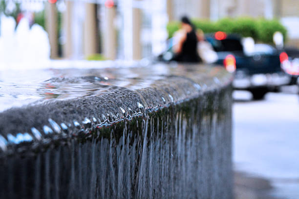 water feature spilling over the edge of a wall in houston texas - deign stock pictures, royalty-free photos & images