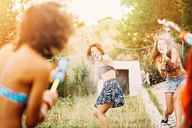 Best Girl Laughing With Water Gun During Water Fight Stock ...