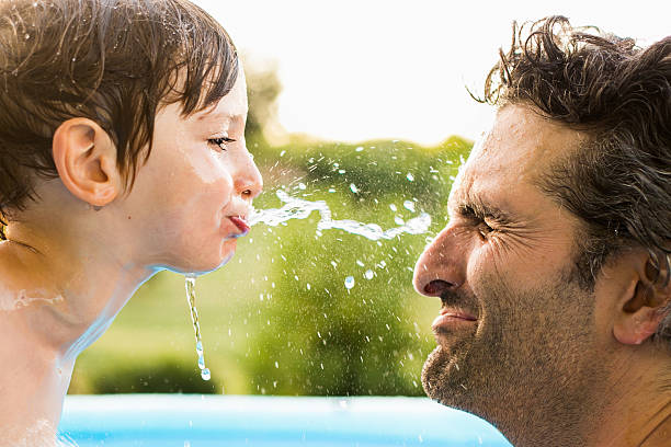 water fight - papa humor stock-fotos und bilder