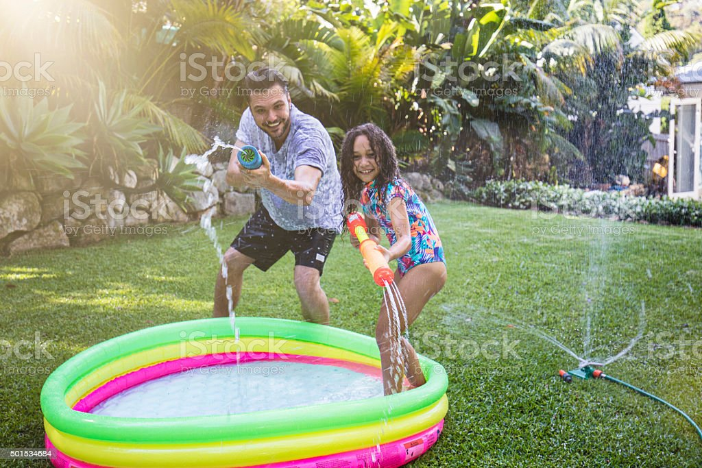 Water fight with dad stock photo