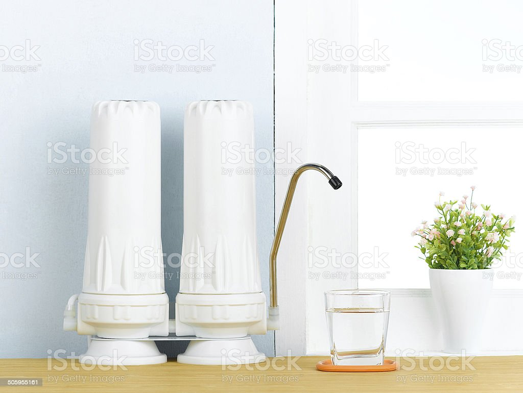 Water filters for better healthy Great water filters to purify your drinking water in the kitchen interior . Cold Drink Stock Photo