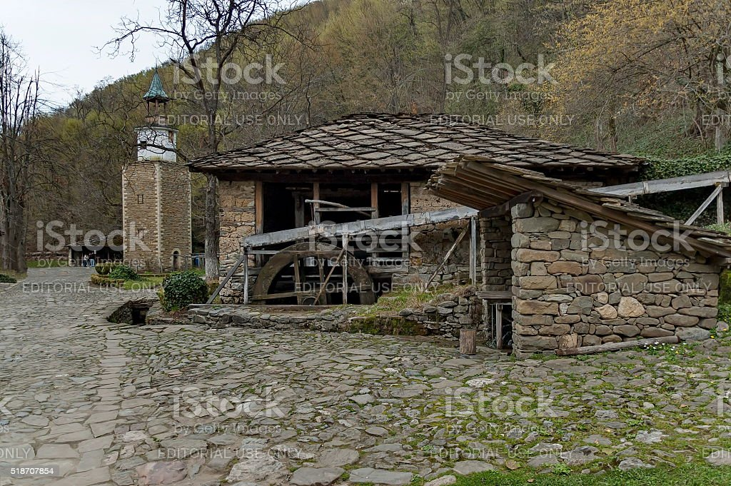 Water flour-mill with mill-wheel and clock tower, Etar, Gabrovo stock photo
