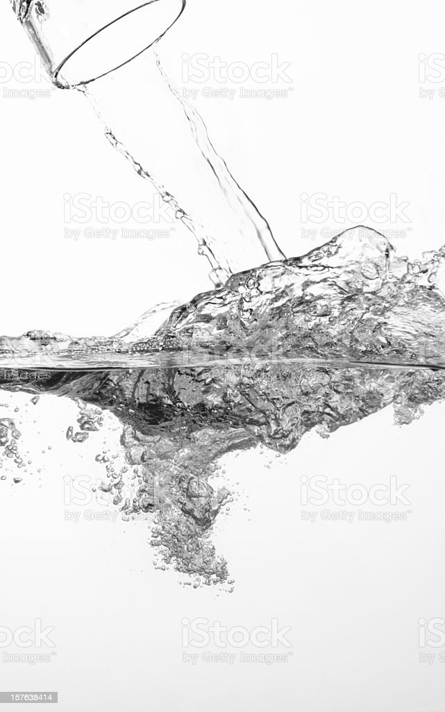 Water flowing and splashing from a glass royalty-free stock photo