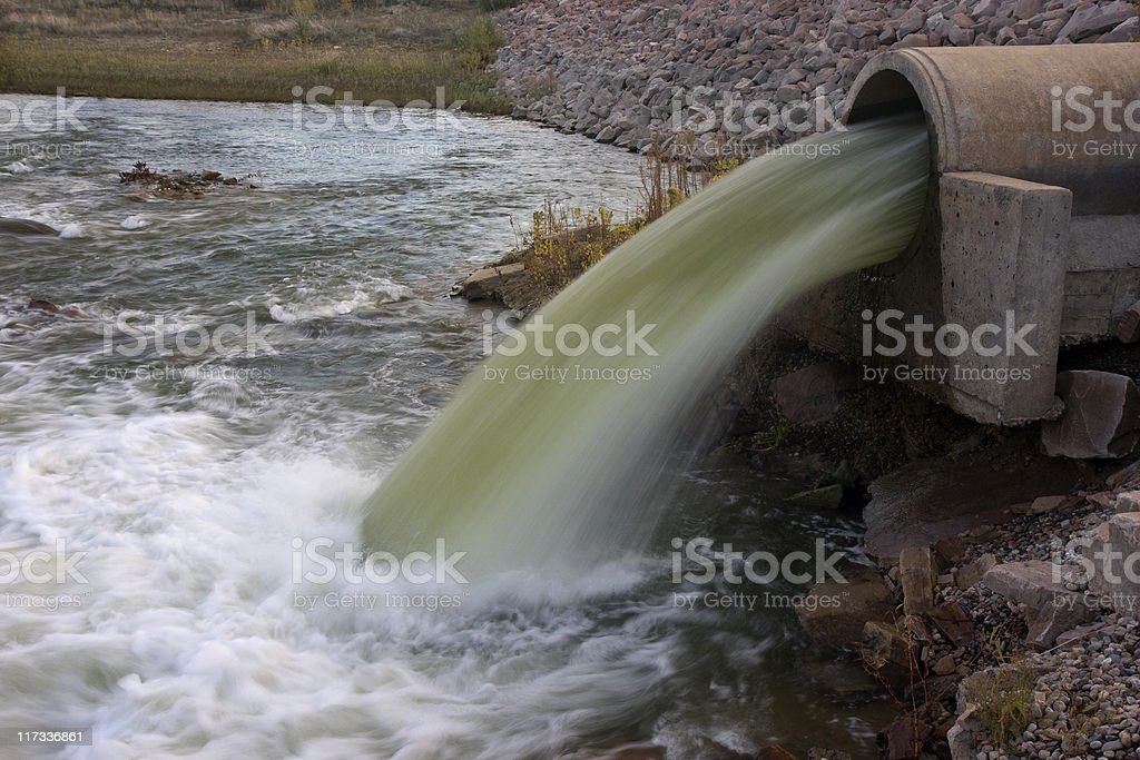 water flowing from a big pipe royalty-free stock photo