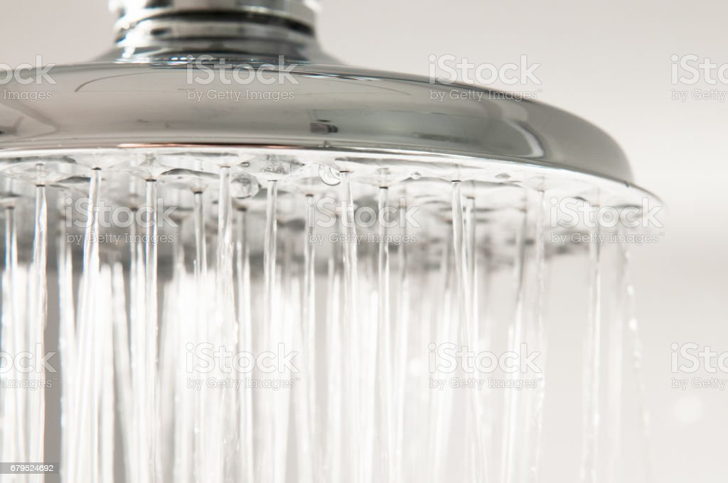 Water flowing from chrome shower stock photo