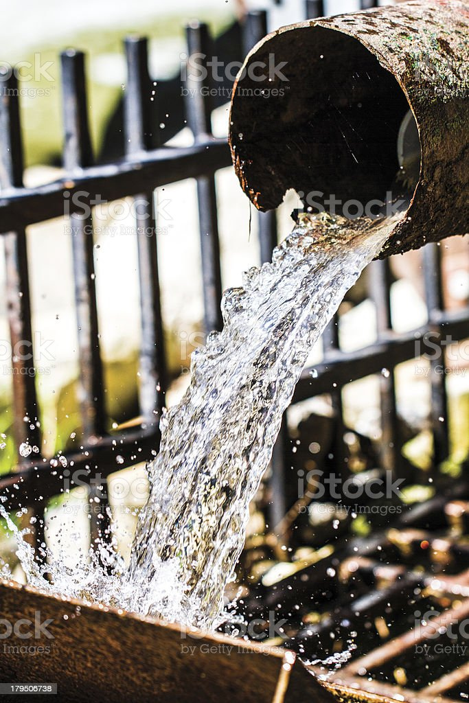 Water flowing from pipe royalty-free stock photo