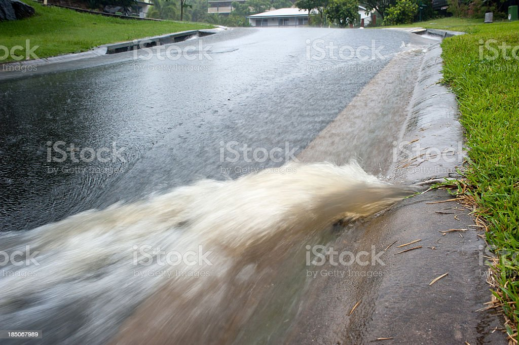 Water flowing from storm-water drain stock photo