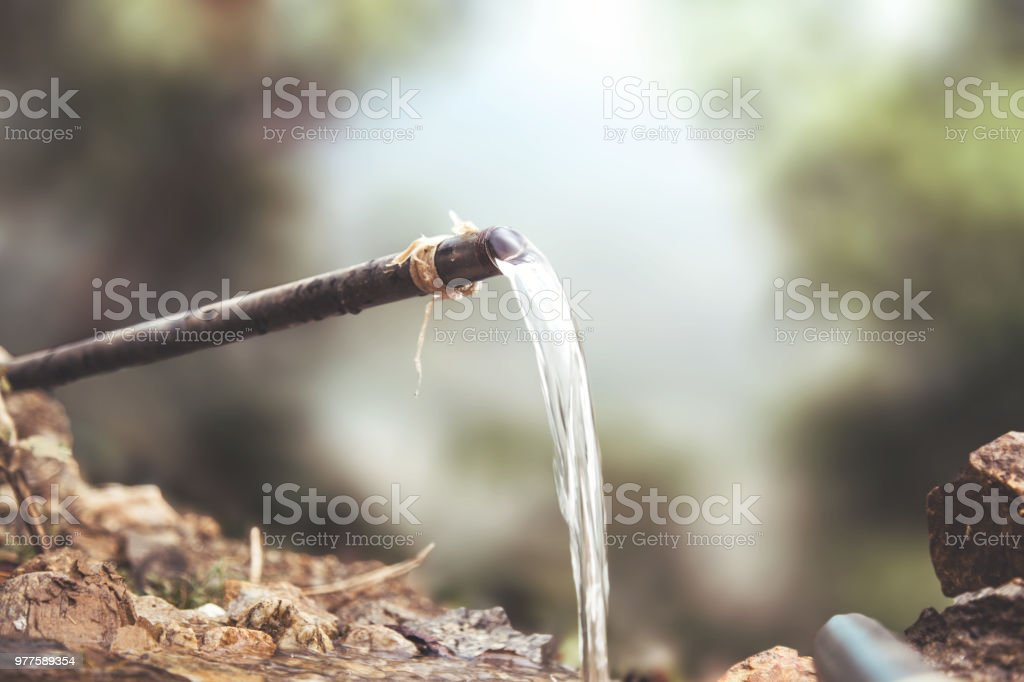 Water Flowing Out Of Pipe stock photo