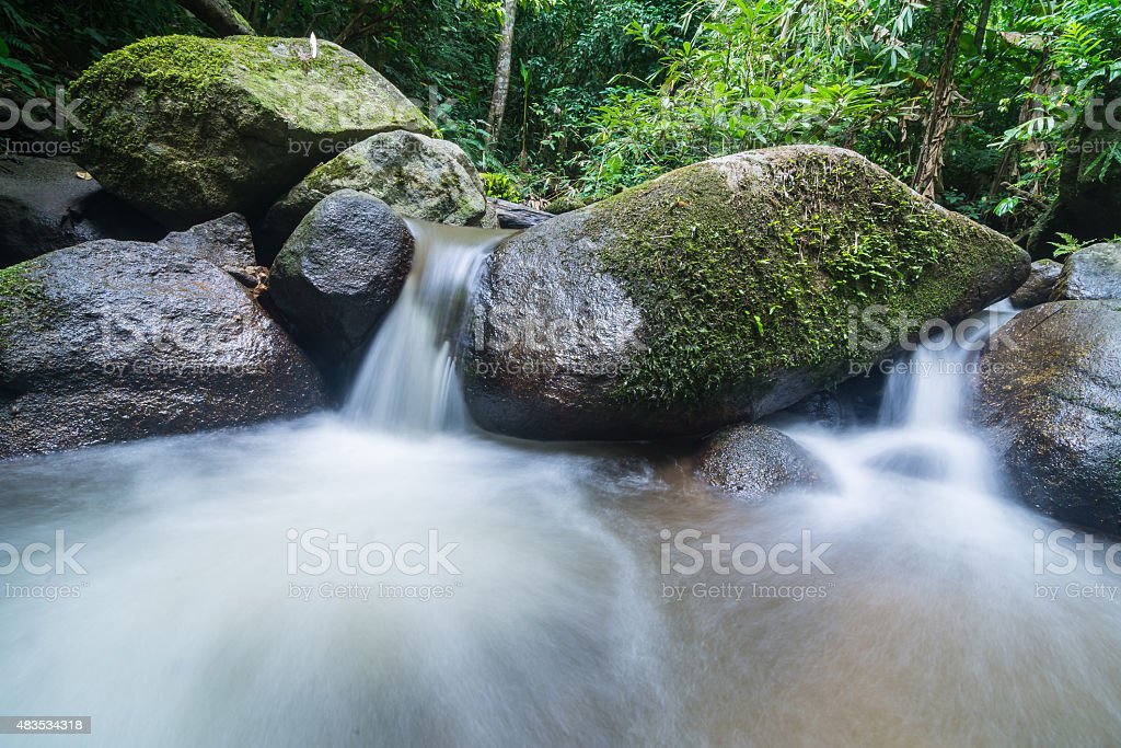 water flowing over the rocks stock photo