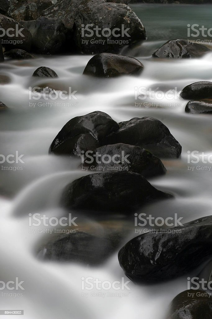 Water flowing through rocks royalty-free stock photo