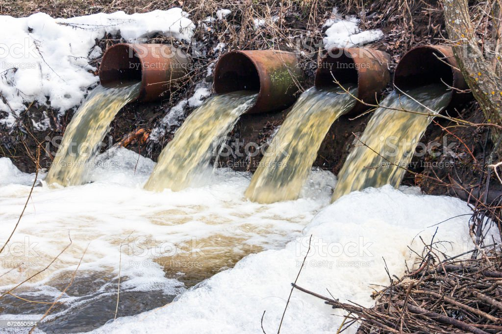 Water flows from large pipes stock photo