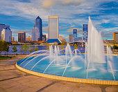 Friendship Fountain spraying water, fountain with water spray, dusk light on fountain, John T. Alsop Jr. Bridge