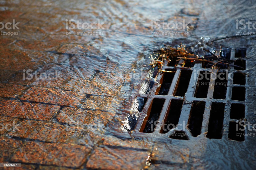 Water flows into the hatch on a spring sunny day stock photo