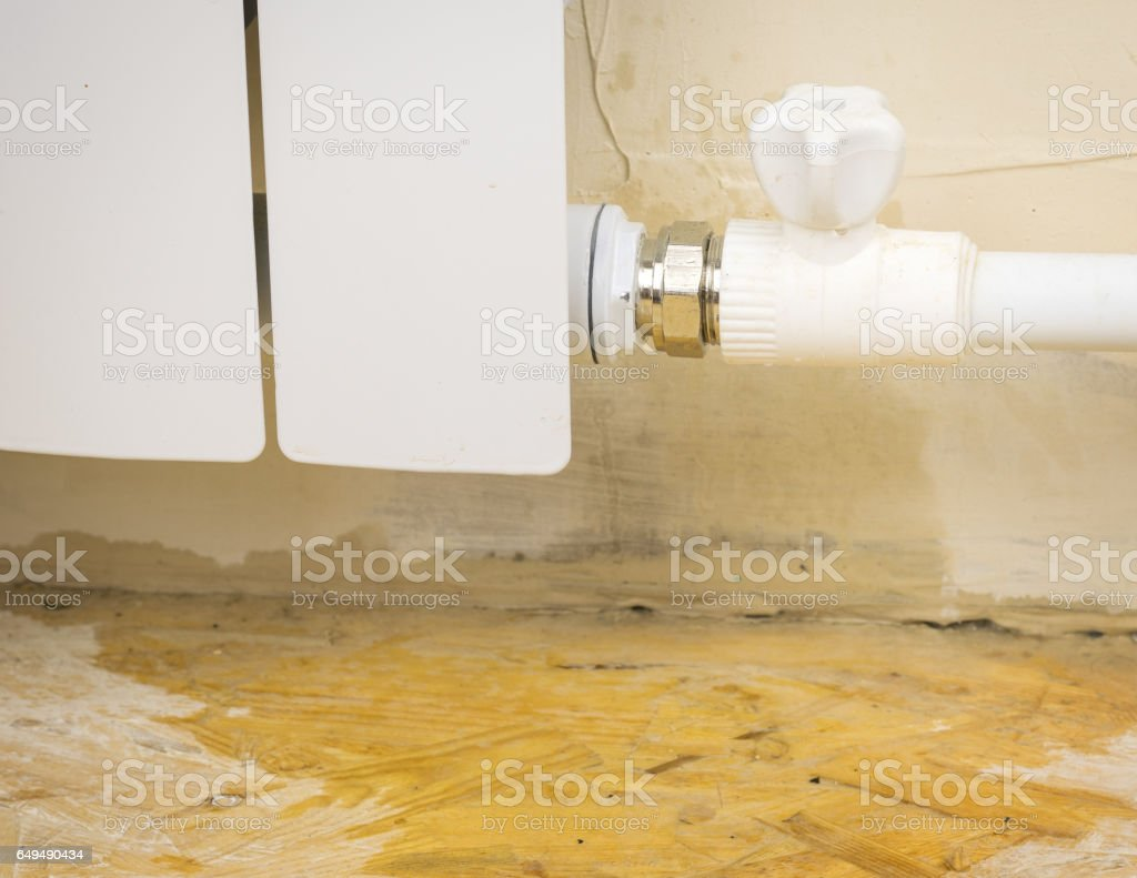 Water flows out of the heating system. stock photo