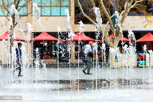 Water fountain in city square, background with copy space, full frame horizontal composition