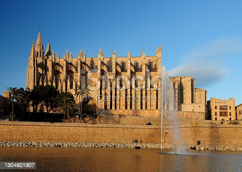 istock Water Fountain In Front Of The Cathedral La Seu Bathed In Golden Sunlight In Palma De Mallorca On Balearic Island Mallorca 1304601907
