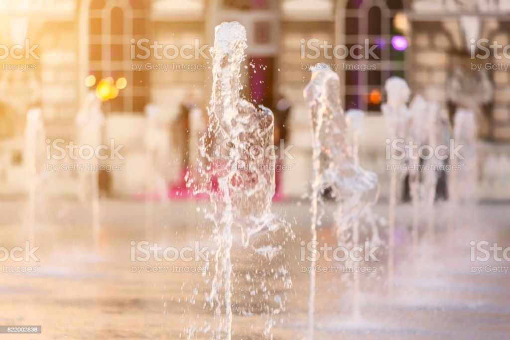 Water fountain jets arranged in a row in London stock photo
