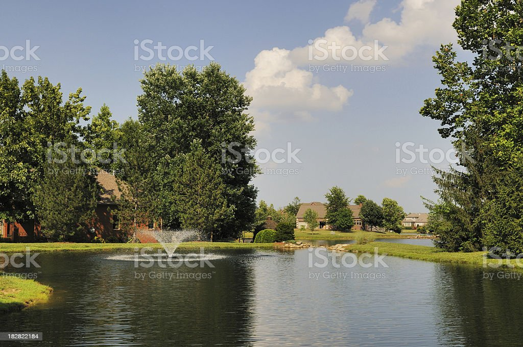 Water Fountain on Lake in Nice American Residental Subdivision stock photo
