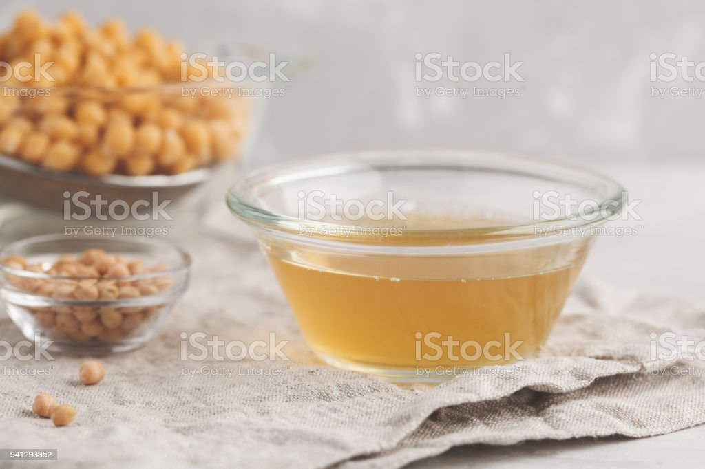 Water from boiled chickpeas - aquafaba. Replace egg in baking for vegan recipe. Healthy diet concept. stock photo